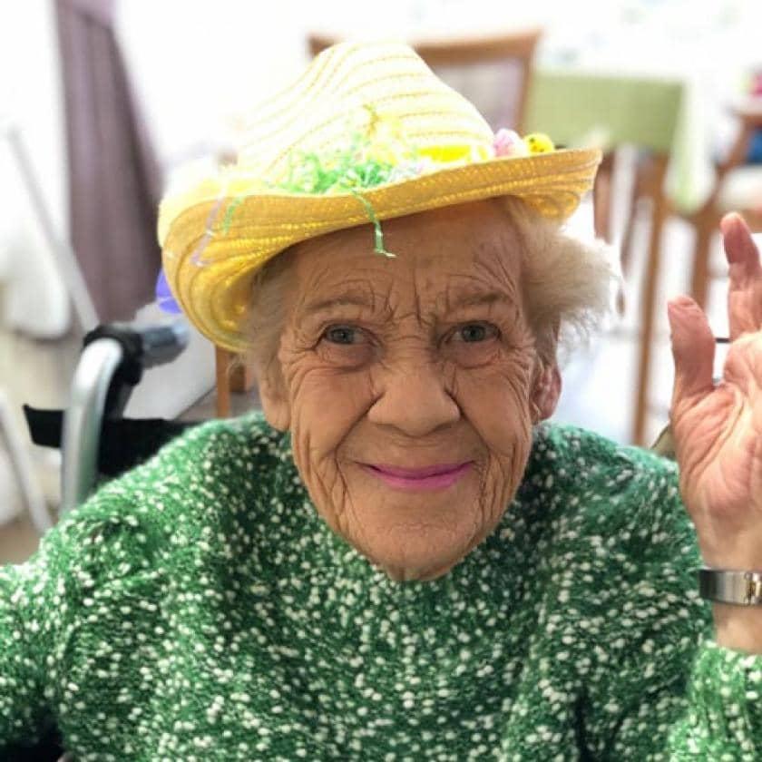 A resident modelling her Easter bonnet.