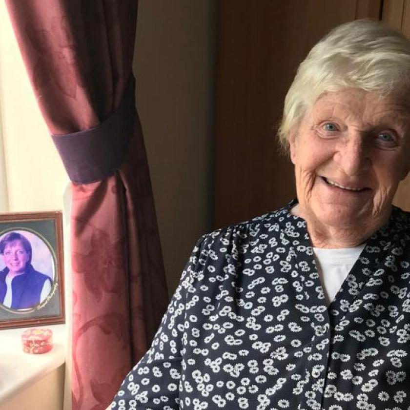 Nursing home resident June Ord enjoying the view of the gardens from her room at Wantage Nursing Home in Oxfordshire