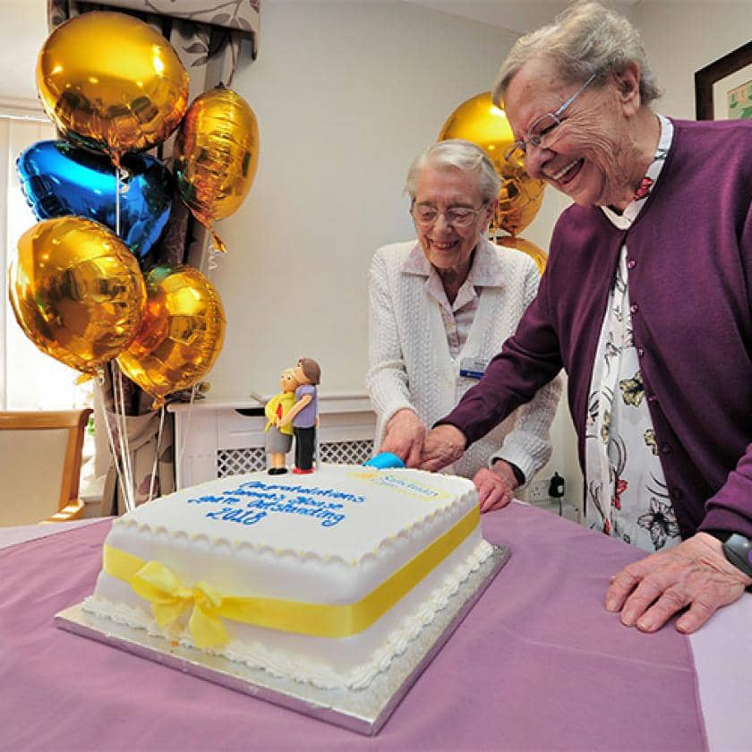 Lammas House residents cutting a cake