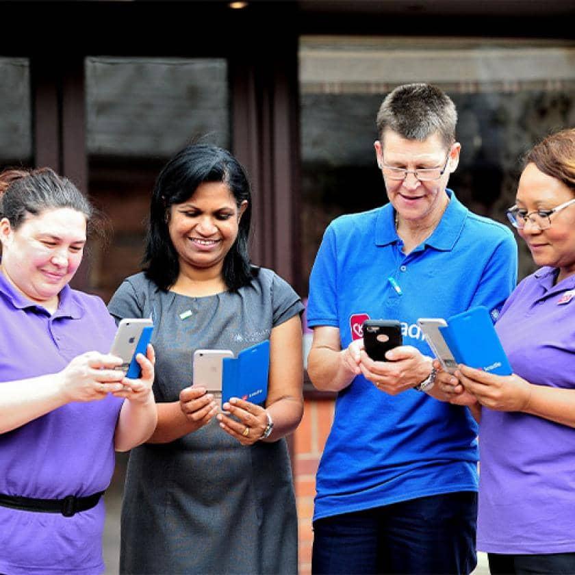 Sanctuary Care staff using their phones