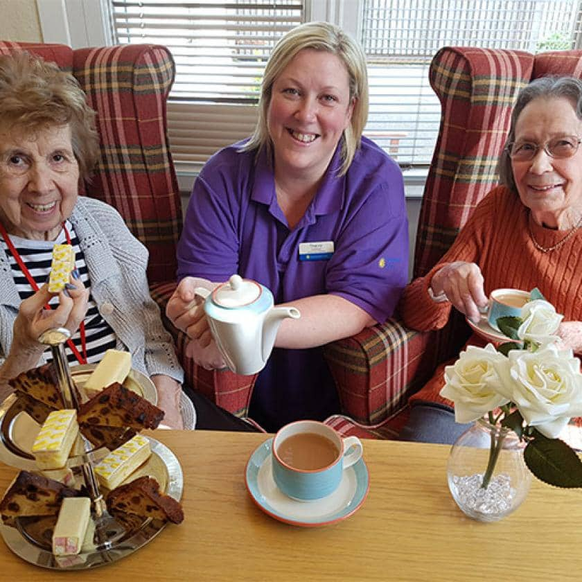 Ravenhurst staff and residents have tea and cake