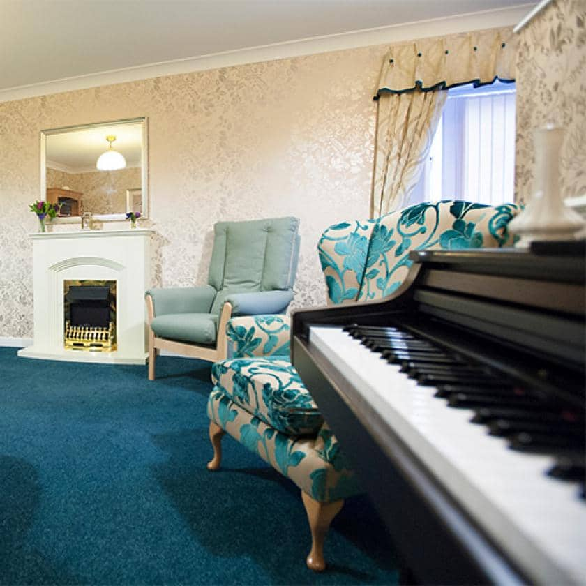 Lounge and piano at Regent care home