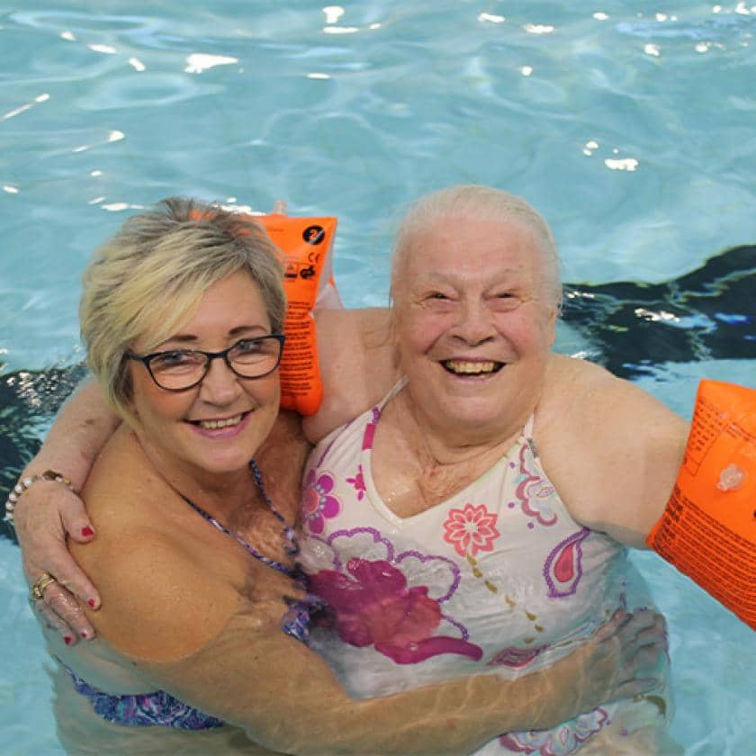 Regent care home staff and resident swimming