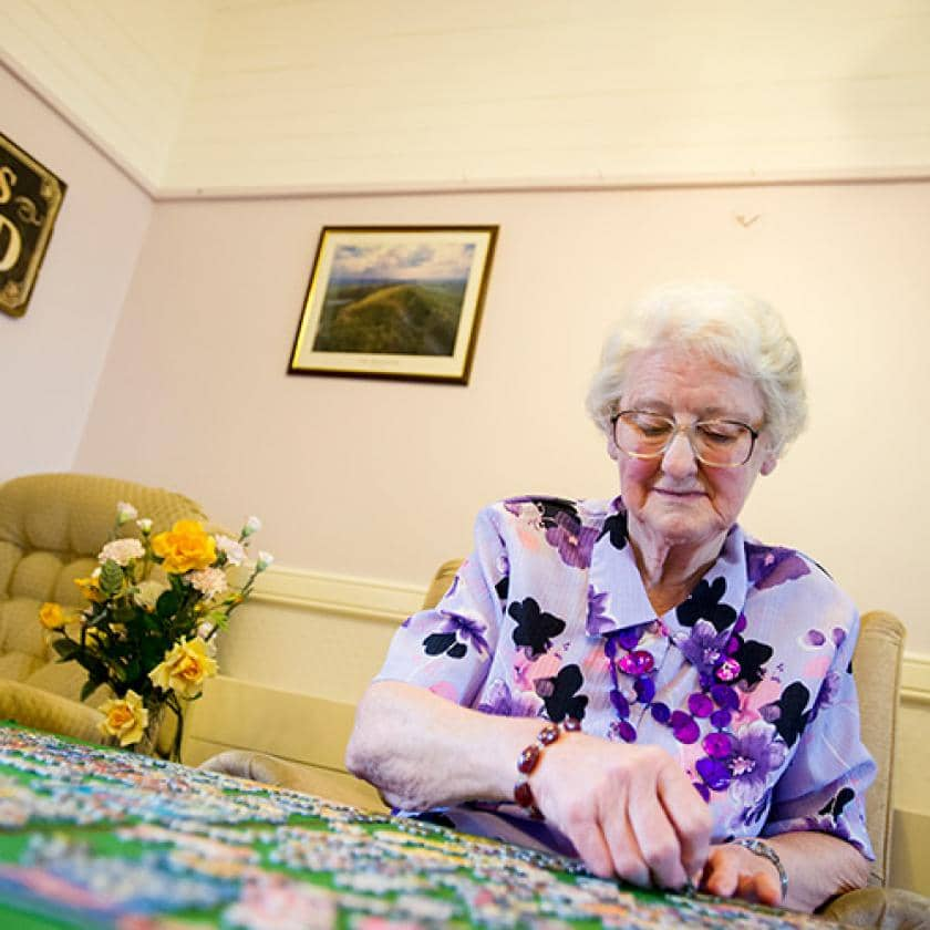 Beechwood resident doing a puzzle