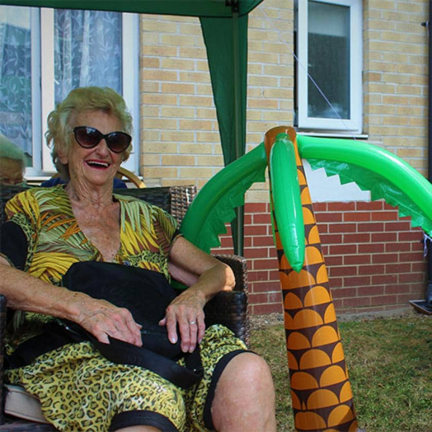 Riverlee resident with inflatable palm tree