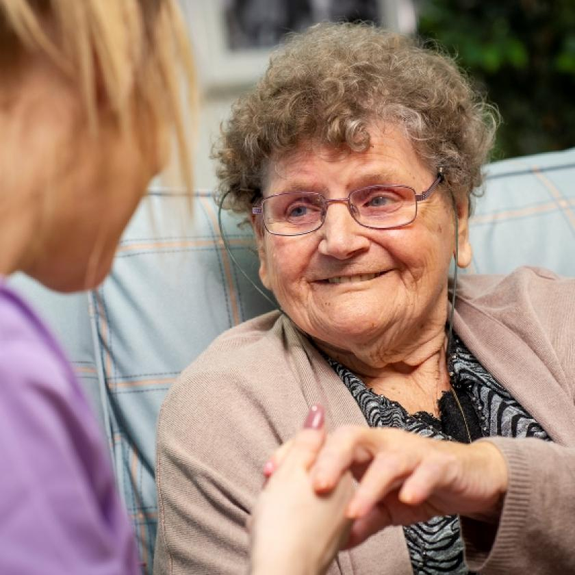 Resident, Kathleen, enjoys a chat with a member of the team