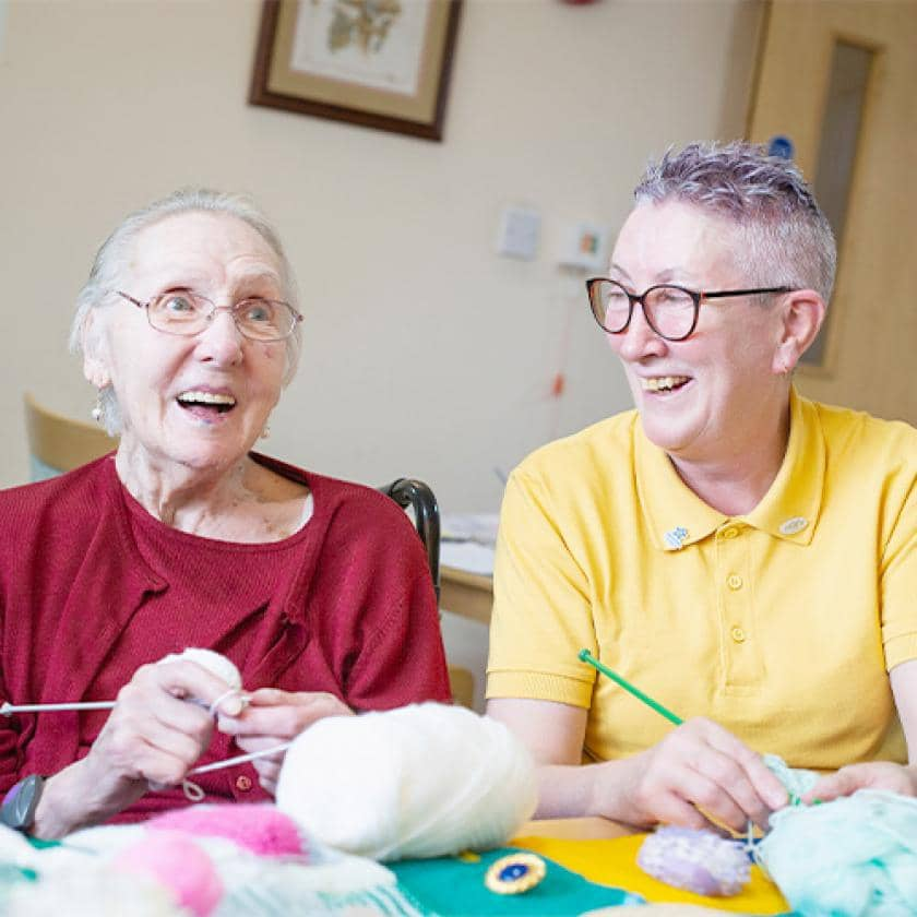 Sanctuary Care resident and staff member knitting