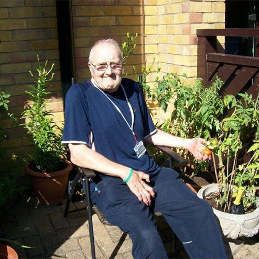 Shaftesbury Court resident sitting in the garden