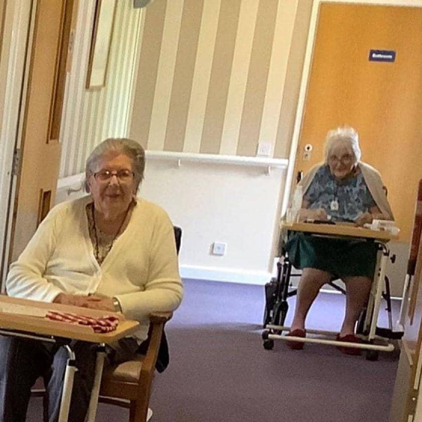 Shaftesbury House residents playing corridor bingo