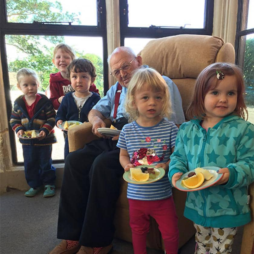 Children with The Rosary resident George and their fruit