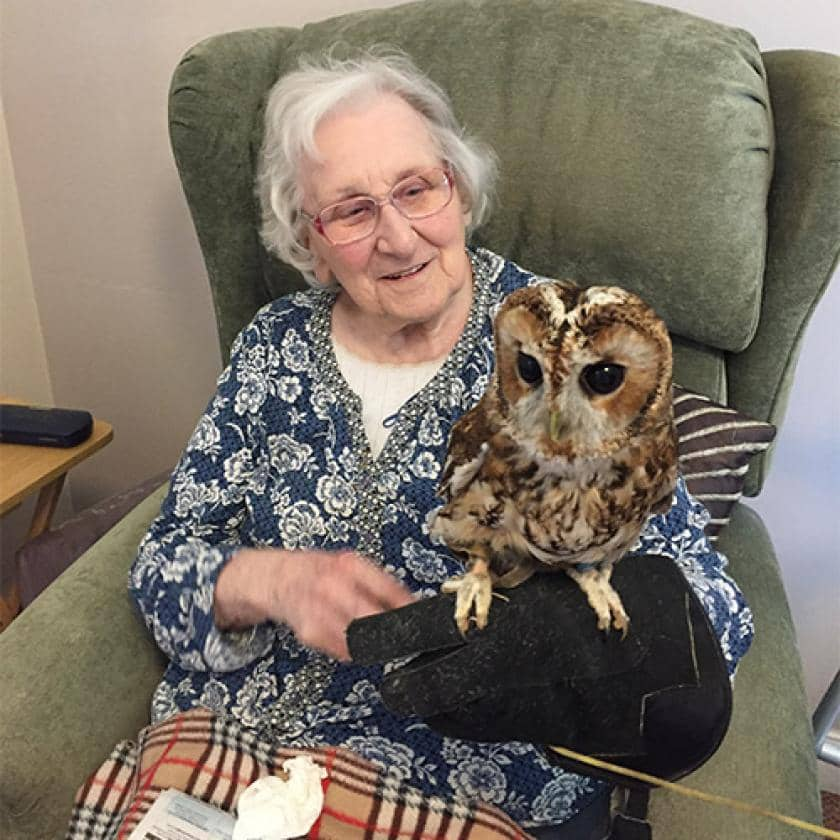 Resident posing with an owl