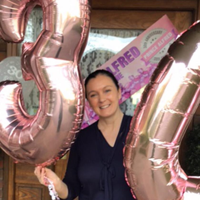 Carer, Cheryl, celebrates her 30th work anniversary with balloons